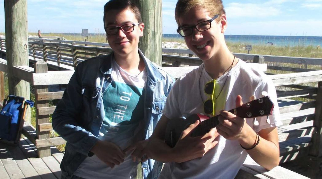 Crestview exchange students posing for picture with ukelele