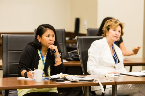 Conference Attendees at a Session