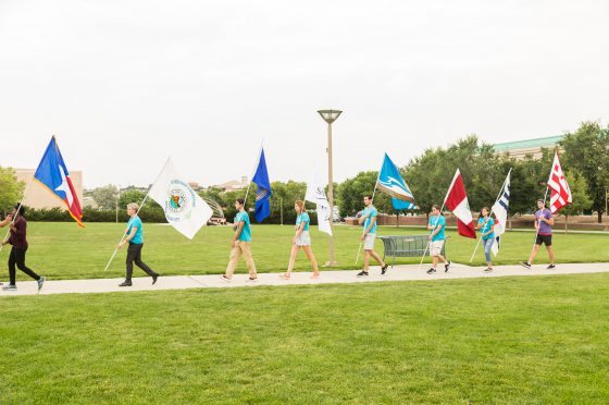 Volunteers Lead the Parade of Flags