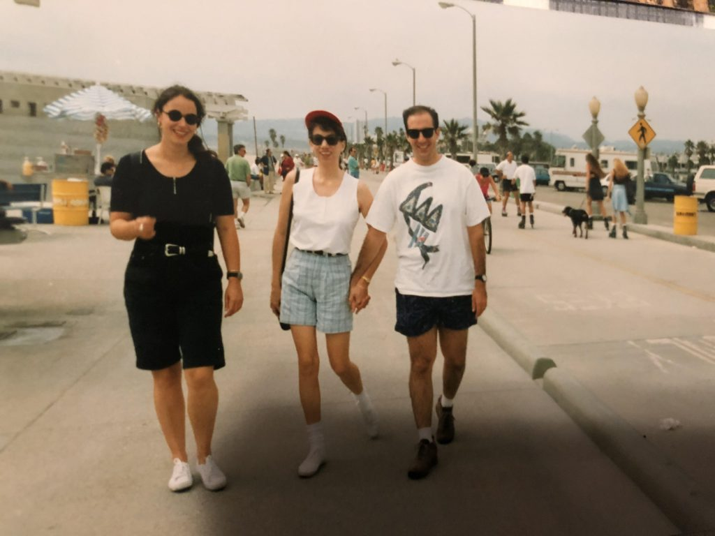 three friends walk along a sunny California street. Picture taken in 1993