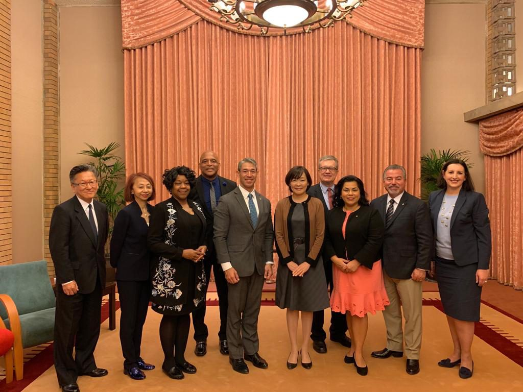 Ron Nireneberg, Mrs. Akie Abe, and staffers pose for a photo