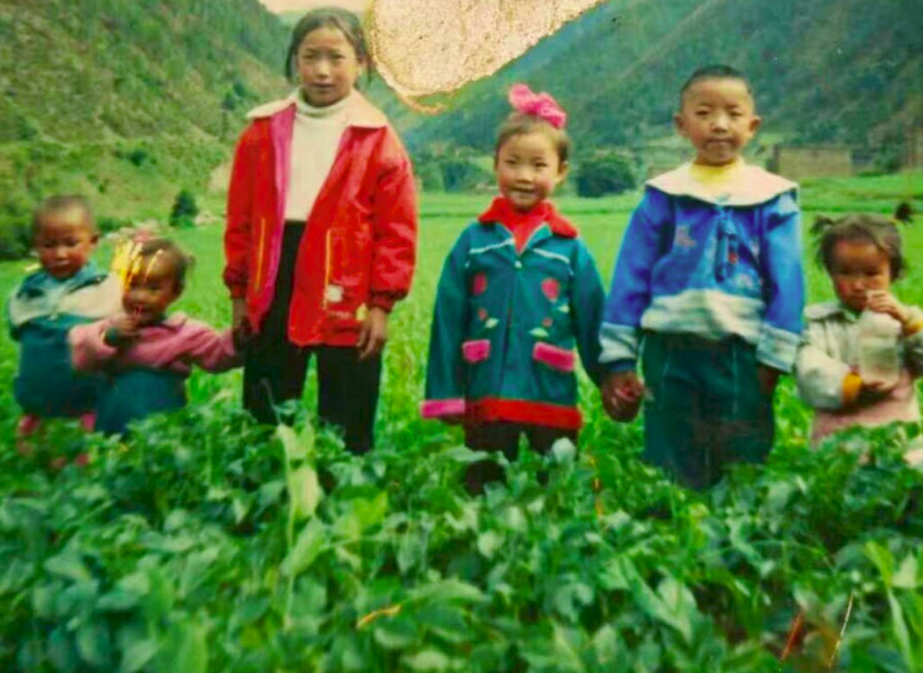 tibeten children in a lush field
